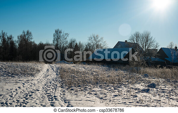 frosty winter day in the village on a background of sky - csp33678786