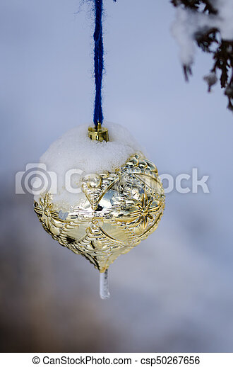 Frozen Christmas Decorations.Frozen Golden Christmas Ornament Decorating A Snowy Outdoor Tree