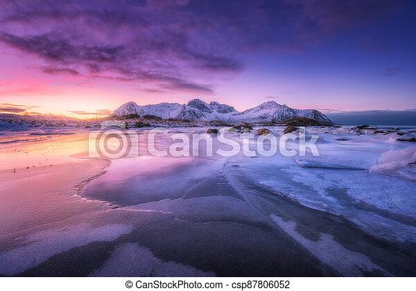 Frozen sea coast at colorful sunset in Lofoten islands, Norway - csp87806052