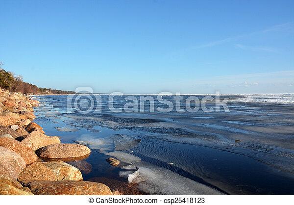 Frozen sea shore at the spring season - csp25418123