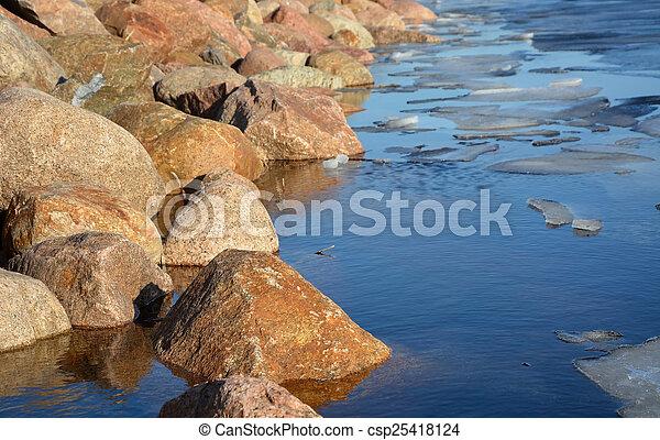 Frozen sea shore at the spring season - csp25418124