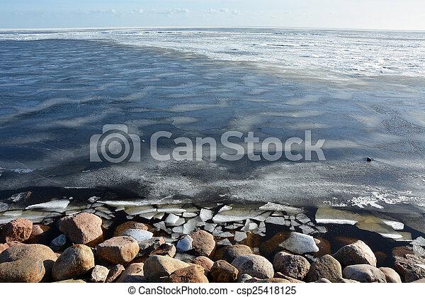 Frozen sea shore at the spring season - csp25418125