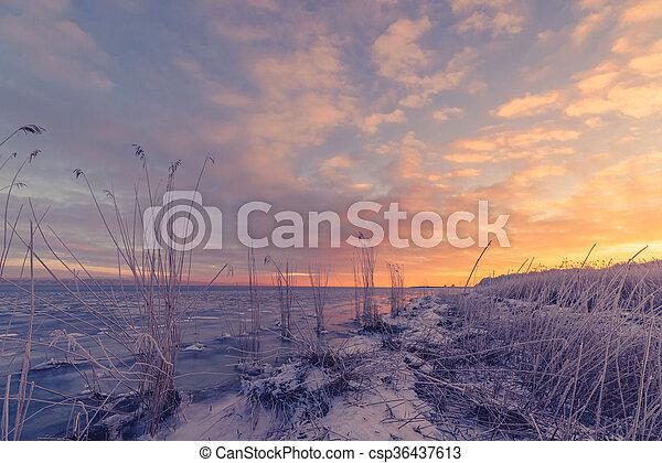 Frozen sea shore in the sunrise - csp36437613