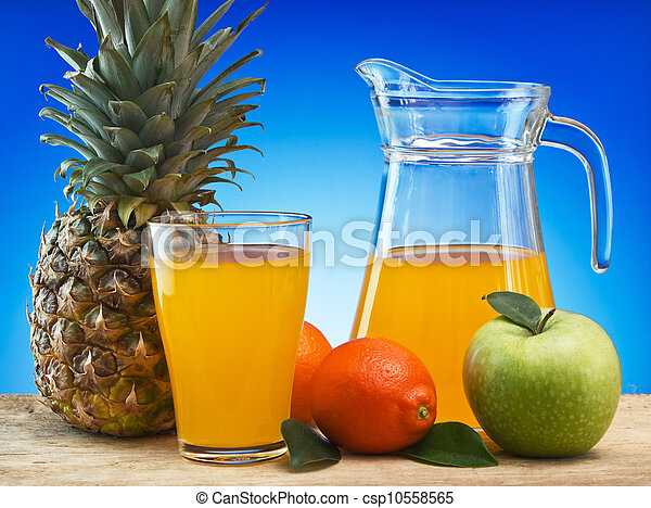 Fruit and juice on a wooden table - csp10558565