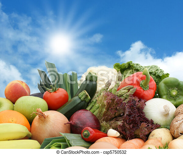Fruit and vegetables against a sunny sky - csp5750532