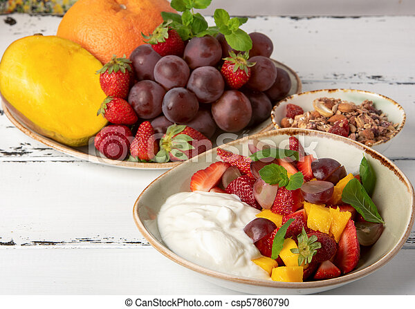Fruit berry salad with yogurt and granola for healthy breakfast - csp57860790