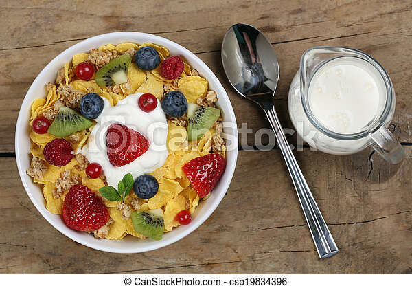 Fruit cereals with yogurt and milk from above - csp19834396