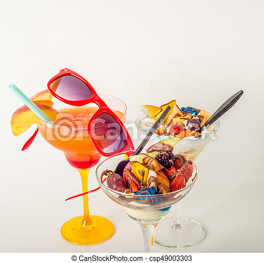 Fruit ice cream, decorated with fresh fruit, chocolate covered, orange drink, margarita glass - csp49003303