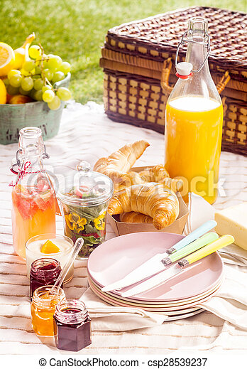 Fruit juice, croissants and fruit for a picnic - csp28539237
