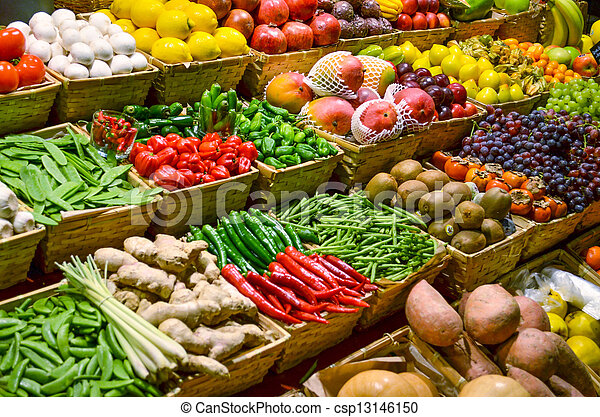 Fruit market with various colorful fresh fruits and vegetables - csp13146150