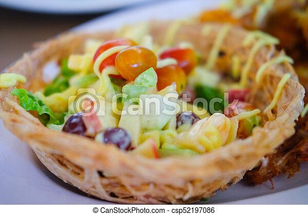 Fruit salad cream in taro basket - csp52197086