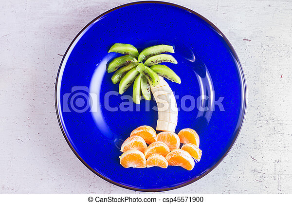 Fruit salad in form of tropical plams - csp45571900