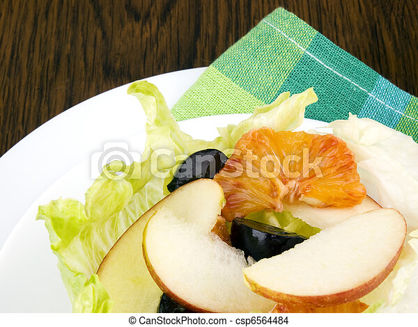 Fruit salad in lettuce leaf - csp6564484