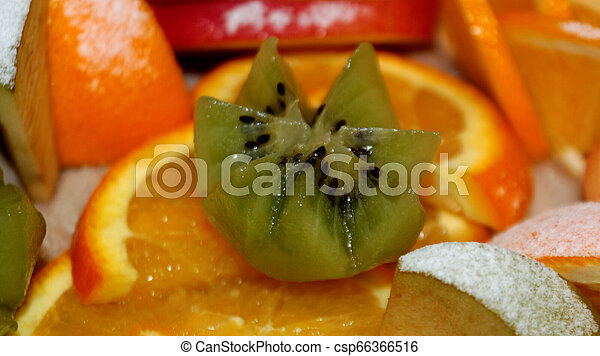 Fruit salad of kiwi, orange, citrus and Apple. Vitamin Breakfast and fresh fruit salad for a healthy lifestyle. - csp66366516