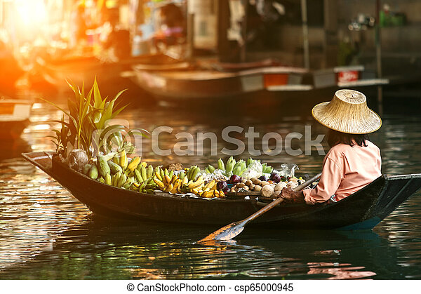 fruit seller in wooden boat - csp65000945