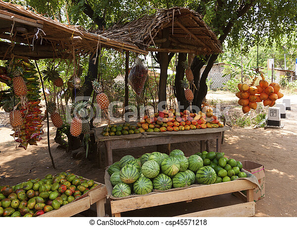 Fruit Vendor's Stall in Sri Lanka with coconut, mango and watermelon - csp45571218