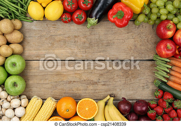 Fruits and vegetables on wooden board with copyspace - csp21408339