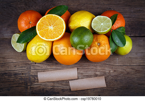 Fruits on wood background with space for text. Organic food. - csp19780010