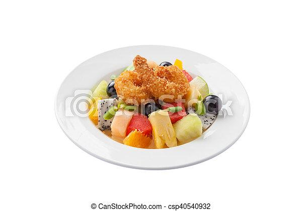 Fruits salad in ceramic dish - csp40540932