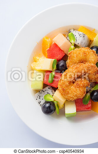 Fruits salad in ceramic dish - csp40540934