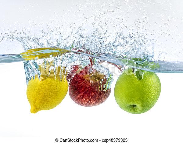 fruits splashing in water - csp48373325