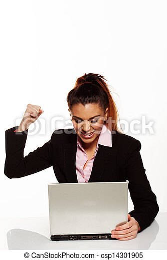 Frustrated woman punching her laptop - csp14301905