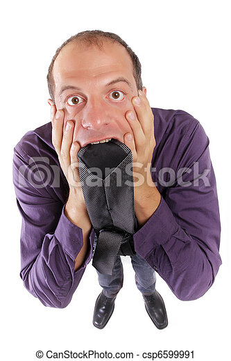 frustred business man biting necktie - csp6599991