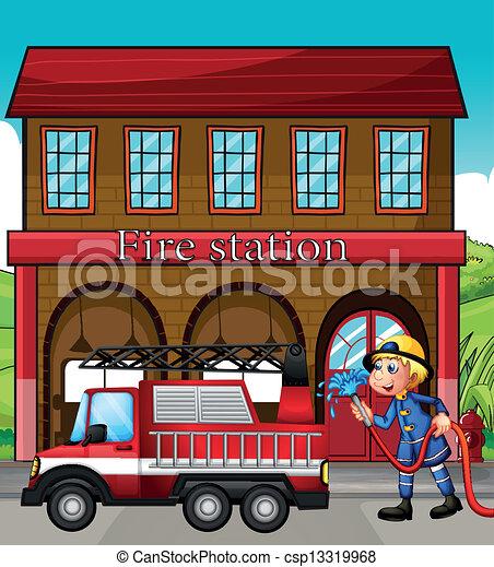 Un bombero y un camión de bomberos frente a la estación de bomberos - csp13319968