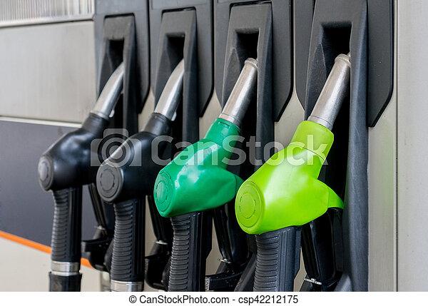Fuel pistols at petrol station - csp42212175