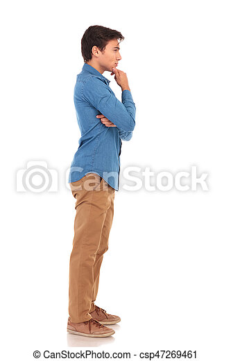 7e2575f6b9ab Full body picture of a pensive casual man looking away from the ...