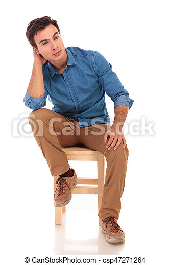 ceea921ec97 Full body picture of a seated casual man dreaming away on white ...