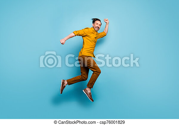 Full Body Profile Side Photo Of Cheerful Crazy Man Jump Run After Spring Time Black Friday Sales Feel Rejoice Emotions Wear