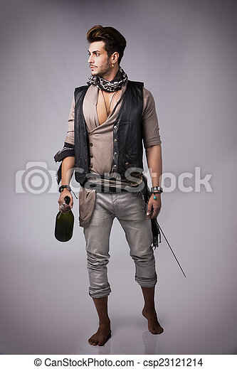 Full Body Shot Of Good Looking Young Man In Pirate Fashion Outfit On Gray Background Captured Studio