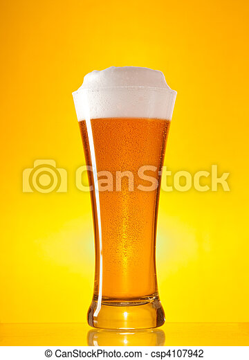 Full glass of beer with froth  - csp4107942