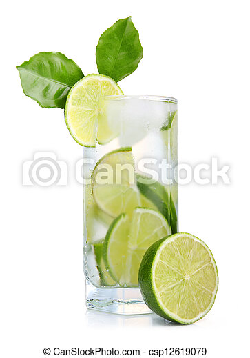 Full glass of fresh cool tonic with lime fruits isolated - csp12619079
