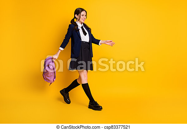 Full length body size view of her she nice attractive pretty cheerful cheery schoolgirl nerd going back to school carrying violet bag isolated bright vivid shine vibrant yellow color background - csp83377521