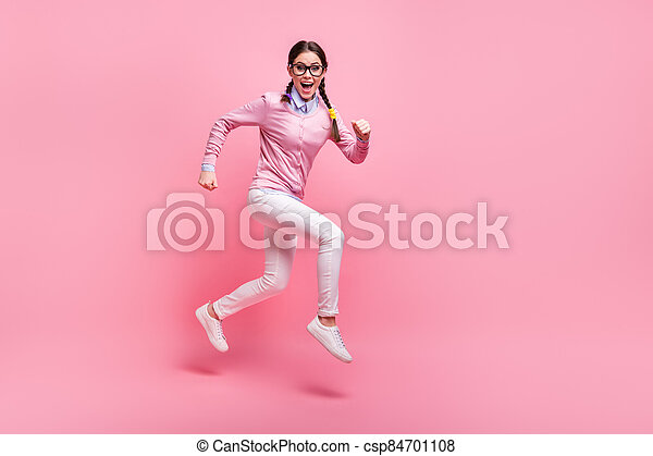 Full length body size view of her she nice attractive pretty lovely cheerful cheery funky sporty person woman nerd jumping running lesson 1 September isolated pink pastel color background - csp84701108
