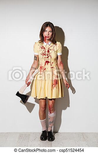Full length image of mad zombie woman posing with axe - csp51524454