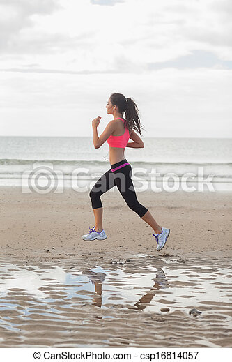Full length of a healthy woman jogg - csp16814057