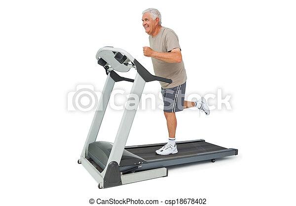 Full length of a senior man running on a treadmill - csp18678402