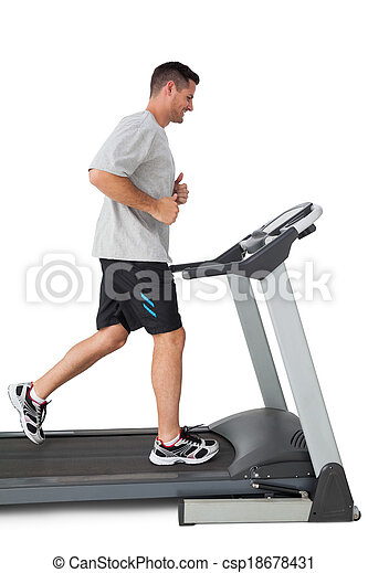 Full length of a young man running on a treadmill - csp18678431