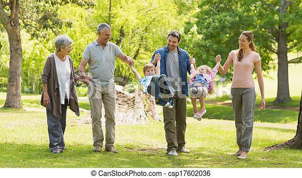 Full length of an extended family in park - csp17602036