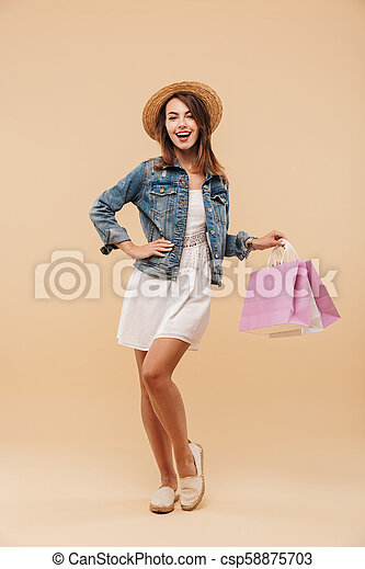 Full length portrait of a cheerful young girl - csp58875703