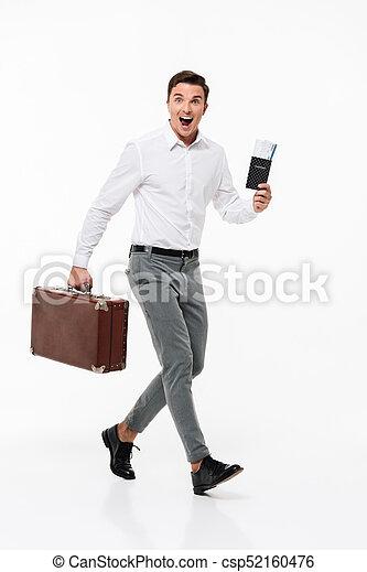 Full length portrait of a joyful attractive man - csp52160476