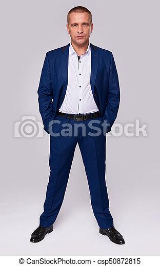 Full length portrait of a serious businessman - csp50872815