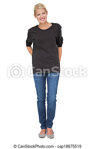 Full length portrait of a smiling young woman - csp18675519