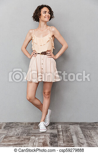 Full length portrait of a smiling young woman - csp59279888