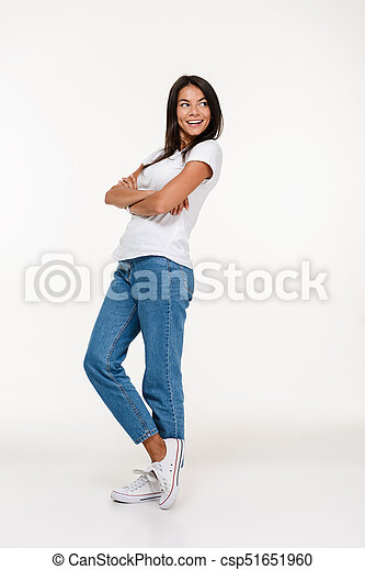 Full length portrait of a young smiling woman - csp51651960