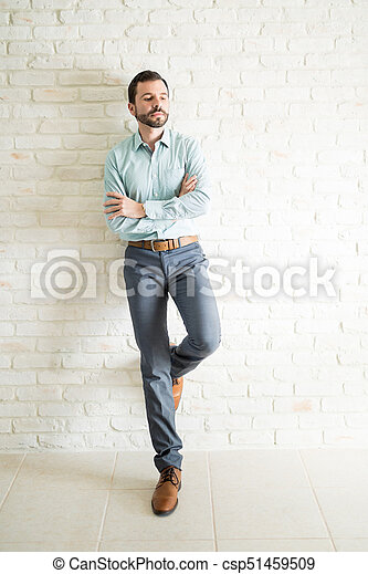 Full length portrait of an attractive man - csp51459509