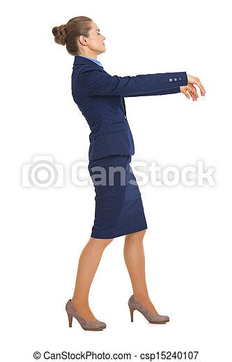 Full length portrait of business woman walking like zombie - csp15240107